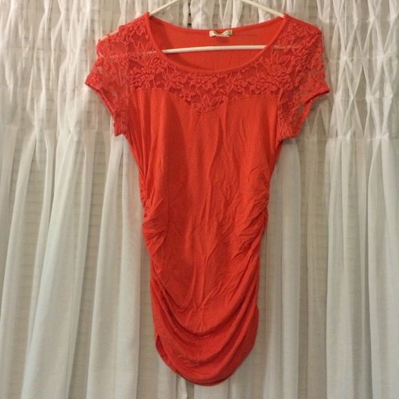 Orange shirt with lace Form fitting orange shirt with lace. Scrunch on both sides! Worn once and in tip top shape! Tops
