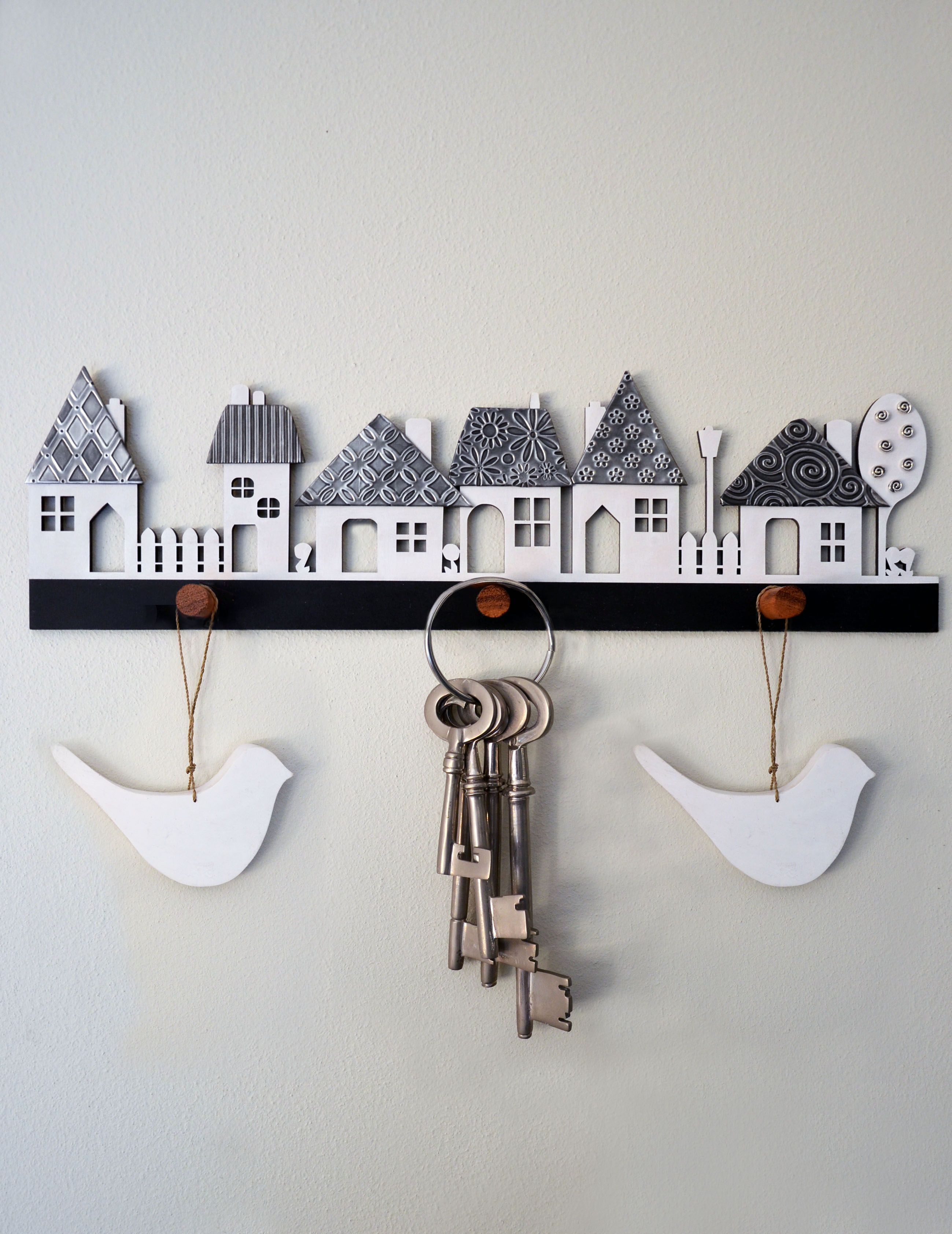 Village wooden cutout with pewter textured roofs kit form from