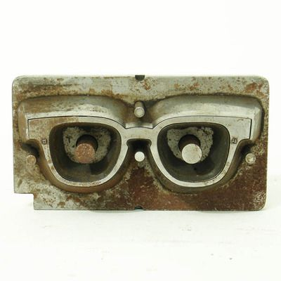 freakyfauna:    1940's industrial mold for horn-rimmed eyeglasses.  Found here.
