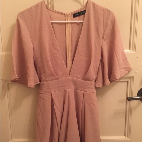 White Fox Boutique nude romper This is a beautiful and chic nude romper. Never been worn and new with the tags. No tears or stains at all. Dresses Mini