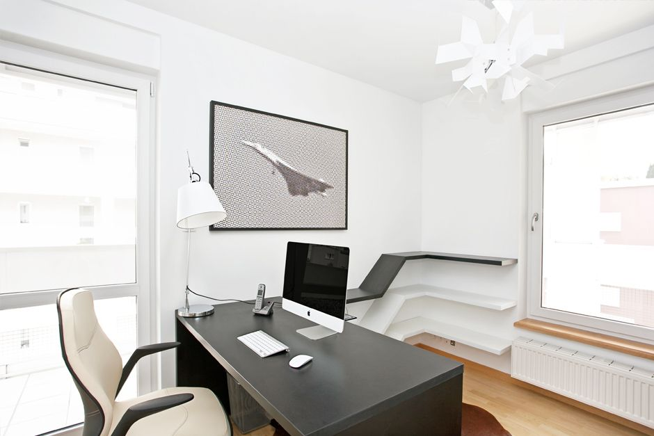 Home Office Room Idea With Aerodynamic Shelving And Black Computer Table  And Modern White Office Chair Gallery
