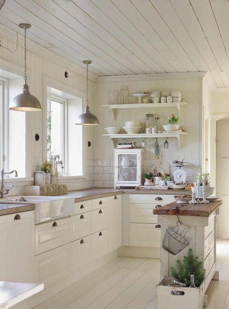 Gentil White Farmhouse Kitchen With Planked Ceiling And Farmhouse Sink.