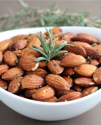 Whole almonds seasoned with fresh rosemary, a dash of chile powder, salt, and placed in the oven to roast.