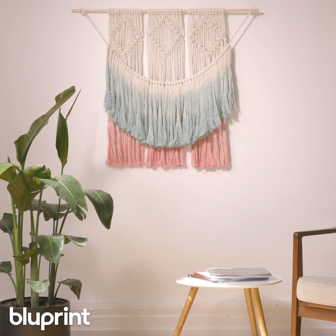 This dip-dye DIY macrame wall hanging is large and yet SO simple to make. If you're looking to venture into macrame, this project is a great one for beginners. We've got you covered with a step-by-step tutorial on how to make this boho beauty! #macrame #macramewallhanging