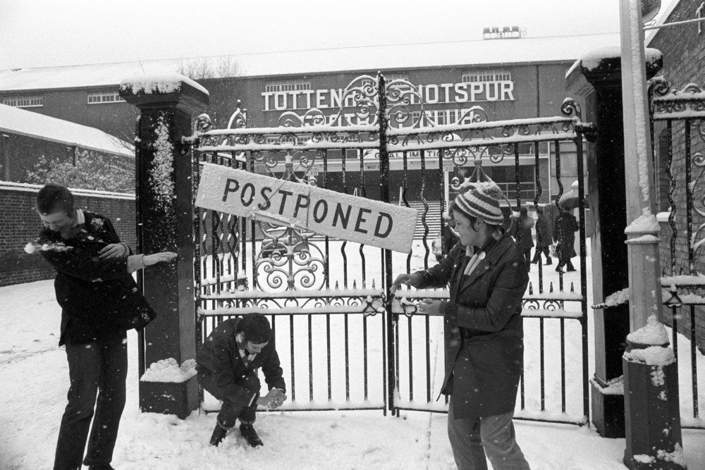 Young Tottenham supporters enjoy a snowball fight outside the gates of White Hart Lane, Nov 1969