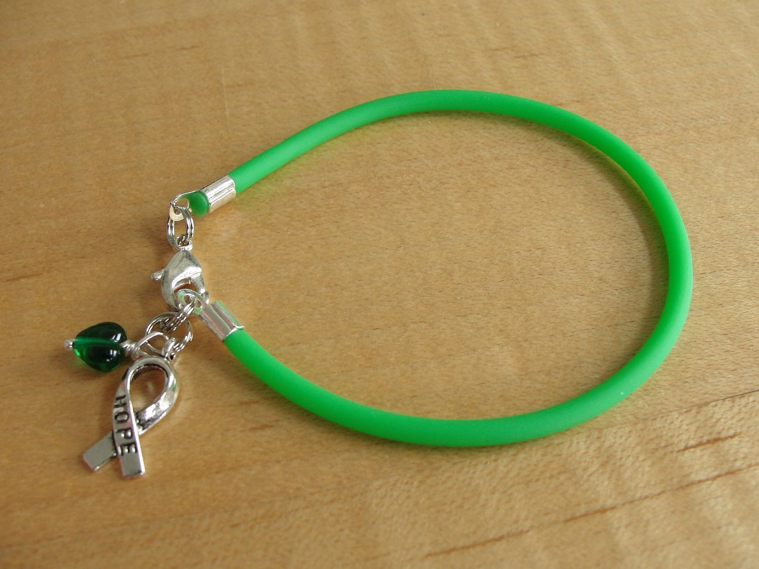 hand love cancer p celiac initial il ribbon bracelet disease awareness with emerald alphabet green liver infinity charm fullxfull stamped optional
