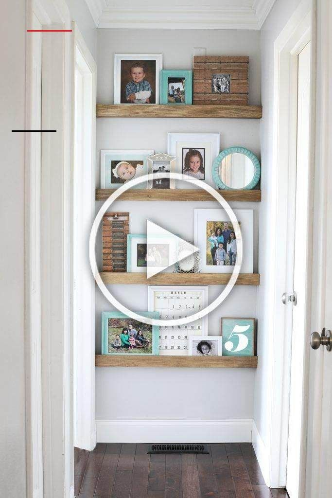 These picture ledge floating shelves can be built in just a few hours for around $20.  #pictureledge #photowall #myhomevibe #homedecorinspo #myhomestyle #diyhomedecor #diyblog #diyprojects #easydiy #buildlikeagirl #woodprojects #photodisplay #bhghome #homedecorideas #hallwaydecor #diyideas #ontheblog #shelves #shelfie #homedecorlovers<br>