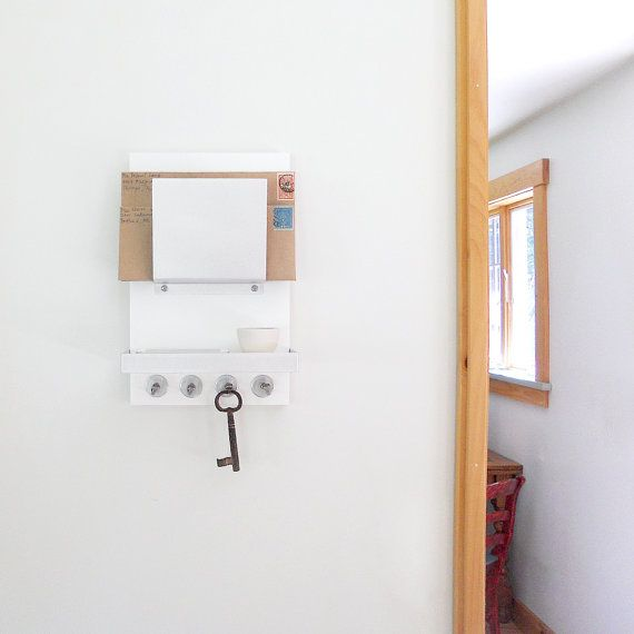 This piece is called MILK Our wall mount mail organizer