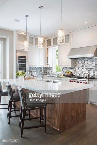 Stock Photo Pendant Lights Over Modern White Kitchen Island