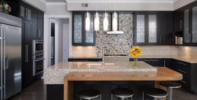 ::: Distinctively Home:  This lovely Mediterranean Contemporary residence in Leawood, Kan., boasts the best of the best.  Cambria quartz countertops make a splash in this well-equipped kitchen featuring Thermador appliances.