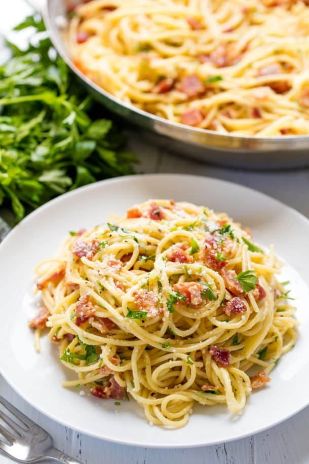 Authentic Pasta Carbonara is part of Carbonara pasta - Authentic Pasta Carbonara is easy to make, full of bacon flavor, and smothered in a cheesy egg sauce that will make you crave more