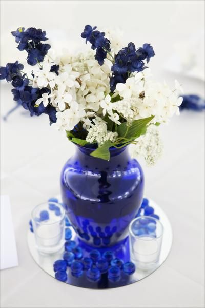 Blue And White Flowers In Cobalt Blue Vase Wedding Table