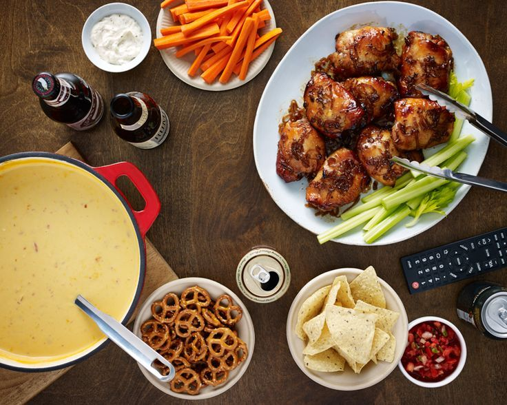 The easiest, most delicious beer-infused Super Bowl party spread... ever! Beer-cheese soup, mini meatballs, smoky chicken thighs; no fancy tablescape required. | DRAFTmag.com #recipe #party