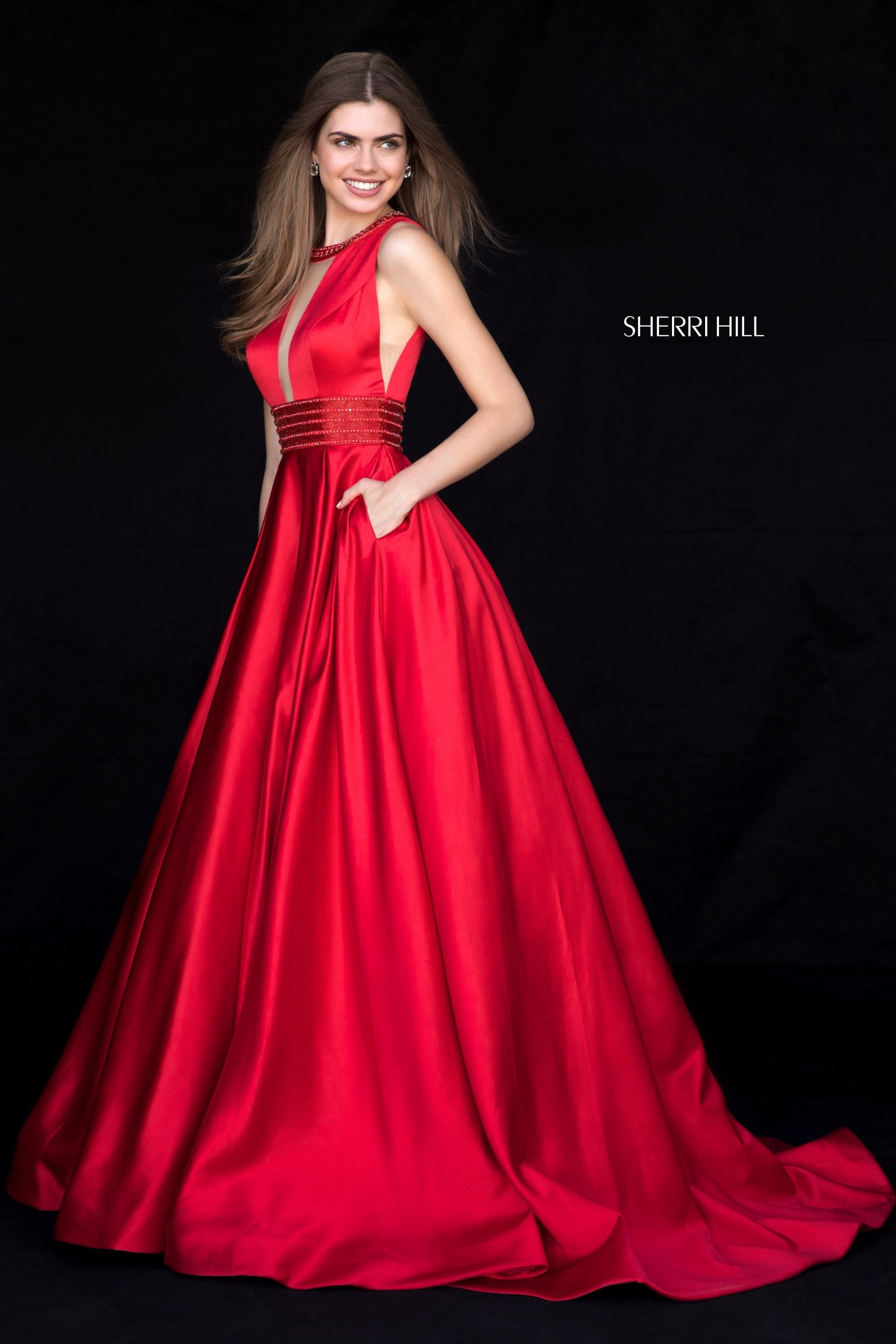 79128d8e295 This  SherriHill 51802 red  prom gown features a tonal-beaded jewel neckline  and waistband
