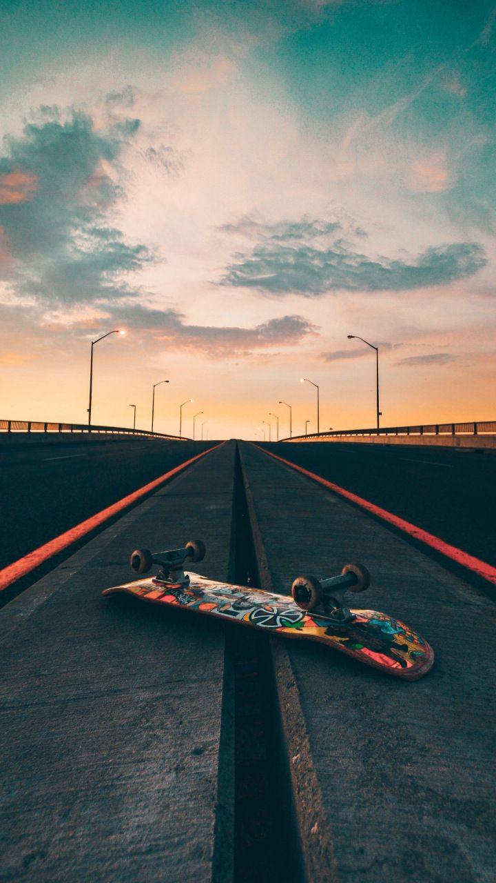 Skateboard, road, marks, sunset, 720x1280 wallpaper