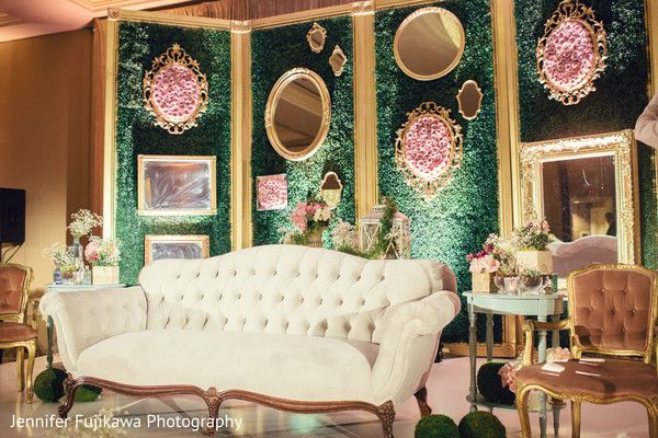 Beach theme wedding backdrops : Mirrors accent a forest green backdrop to create