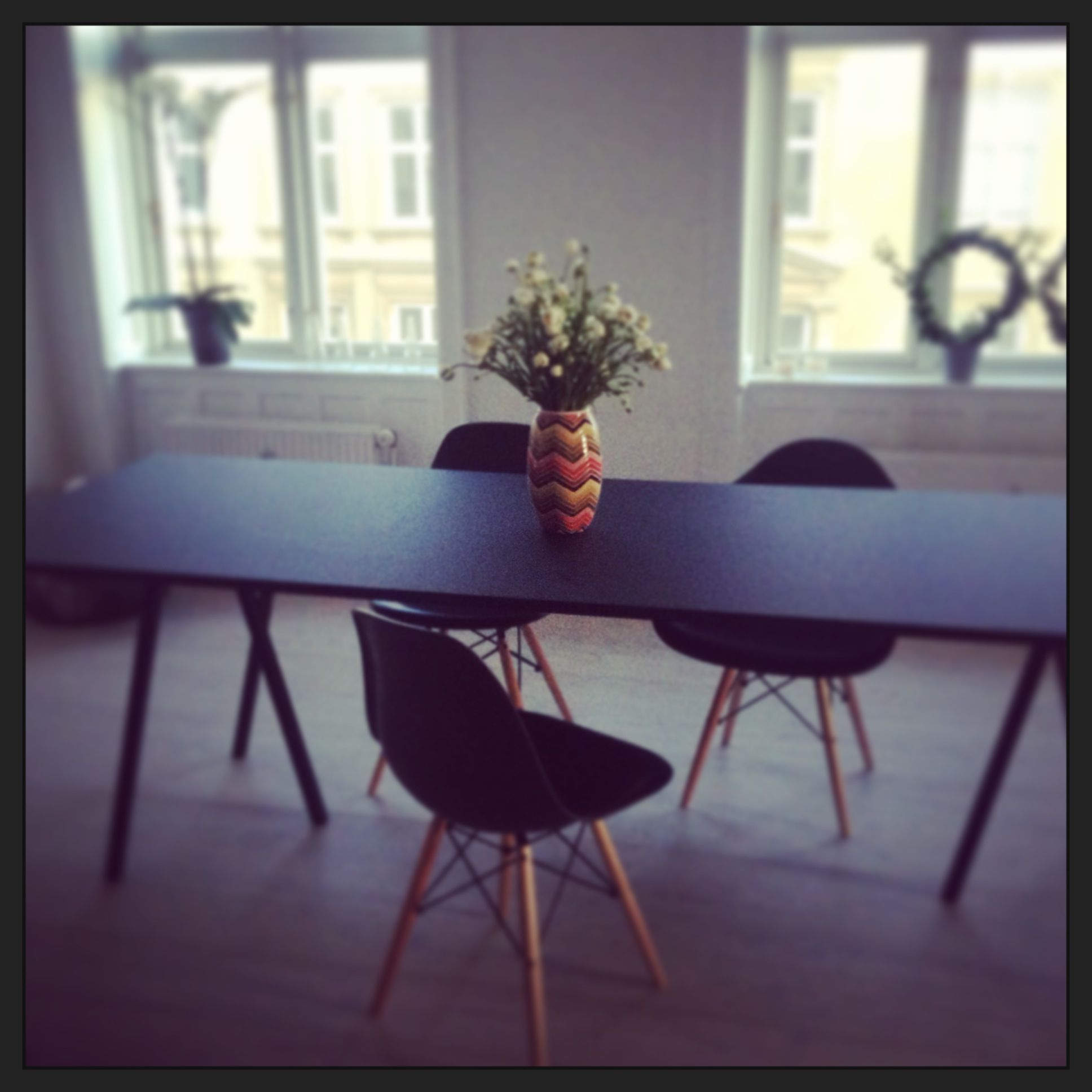 Eames chair, Hay loop stand Table Black, multicolor vase. Copenhagen ...