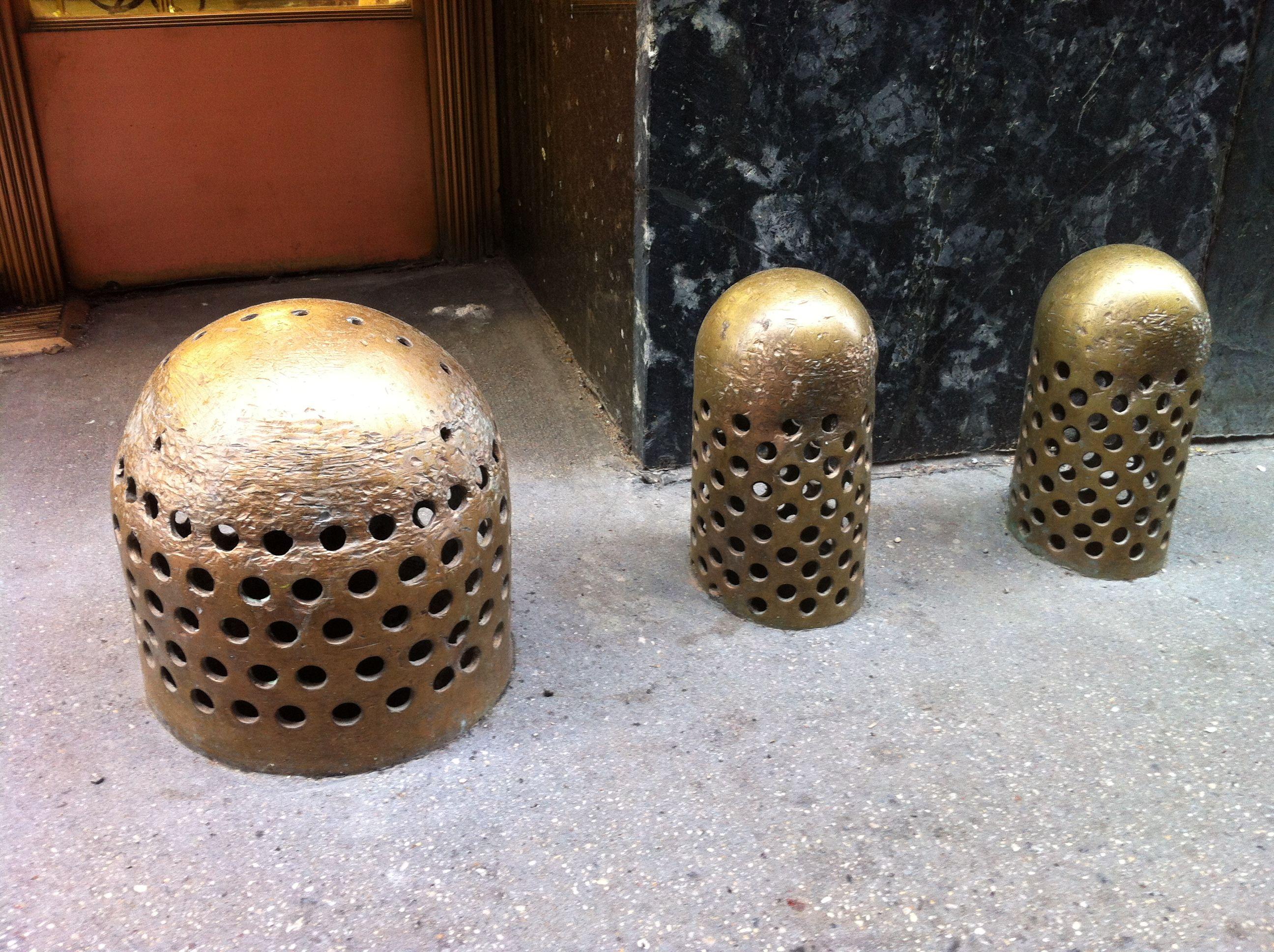 05-08-12: Brass beehives? Sidewalk thimbles? Whiffle warheads?