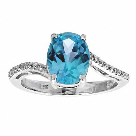 Oval Blue Topaz And Diamond Accent Ring In Sterling Silver