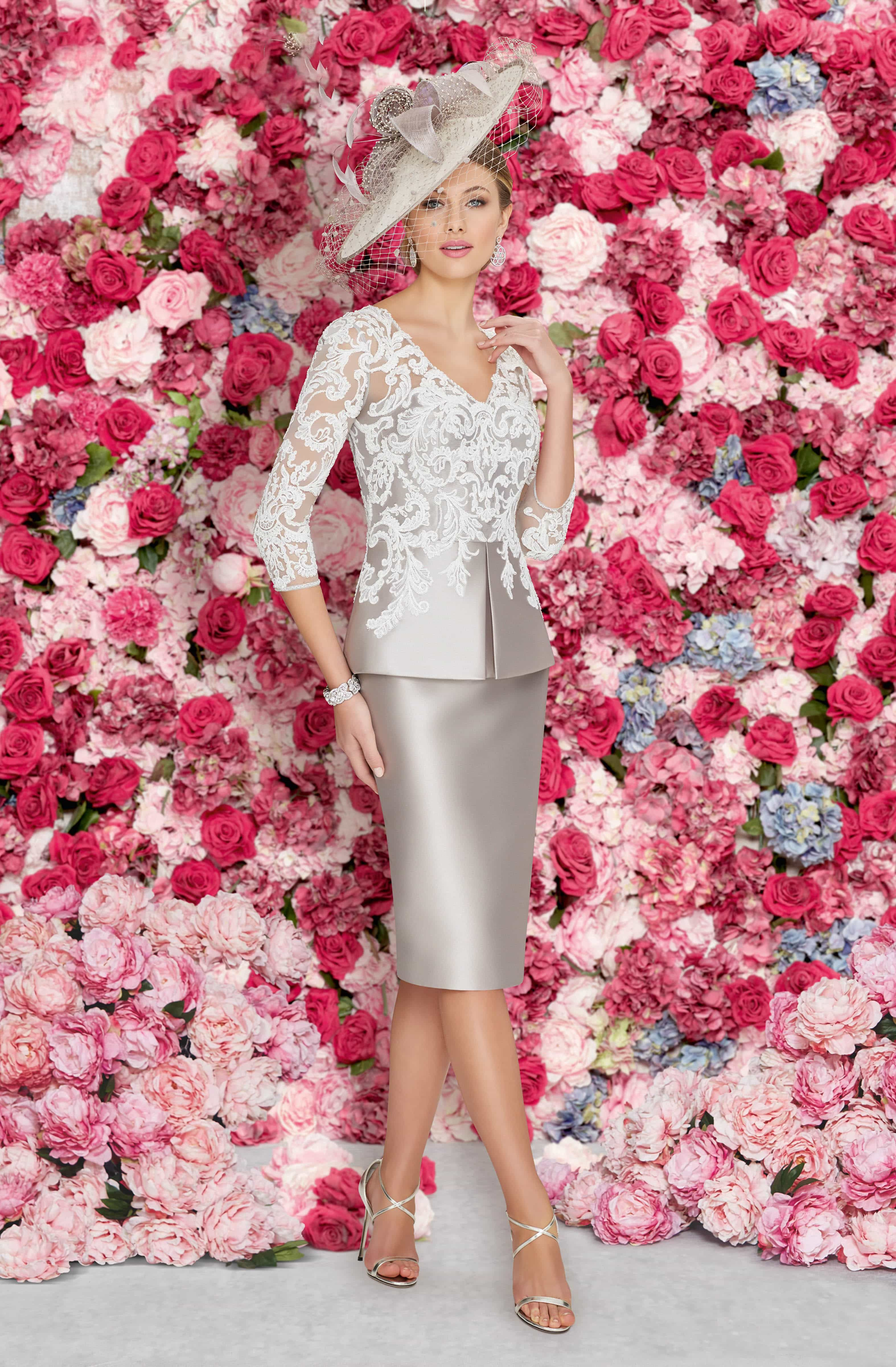 This short fitted dress features a lace bodice with elbow length ...