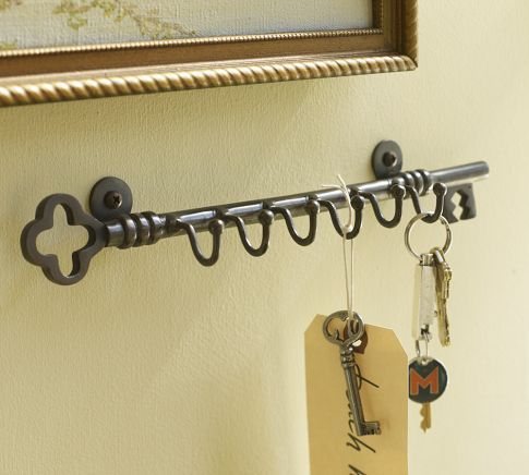 """Key Row Of Hooks $34 A little addition like our key holder can help you make the most of space in an entryway, kitchen or home office.    12"""" wide x 2"""" deep x 2.5"""" high   Made of brass with an antique bronze finish.   Mounting hardware included."""