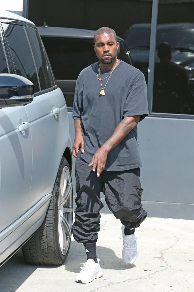Kanye West Wearing Adidas Ultra Boost Running Shoes In White And Adidas Traxion Premier Crew Socks Kanye West Outfits Kanye West Style Kanye Fashion