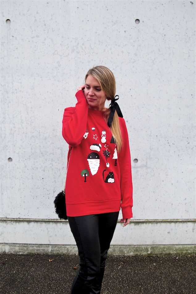 Heartfelt Hunt Christmas Sweater Christmas Sweater Leather Pants Red Coat Faux Fur Bag Chelsea Boots And Blond Ponytail With A Bow Winter Fashion