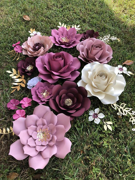 """Handmade Paper Flowers. This listing is for a set of 26 items This set include: 3 Large Flowers 16"""" to 18"""" 4 Medium Flowers 12"""" to 15"""" 4 Small Flowers 6 to 10 9 XSmall Flowers 2 to 5 6 golden leaves Backdrop surface is not included The flowers come fully assembled and #largepaperflowers"""