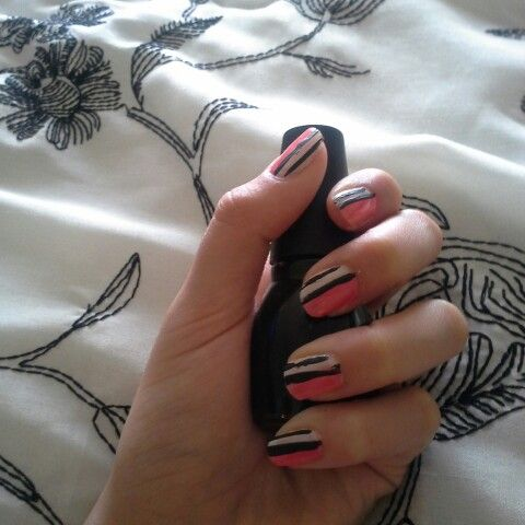 Awesome pink black and white that I did Consists of a striper and just normal nail polish
