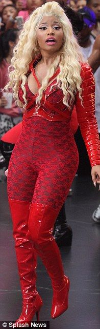What bruised vocal chords? Nicki Minaj rocks another figure