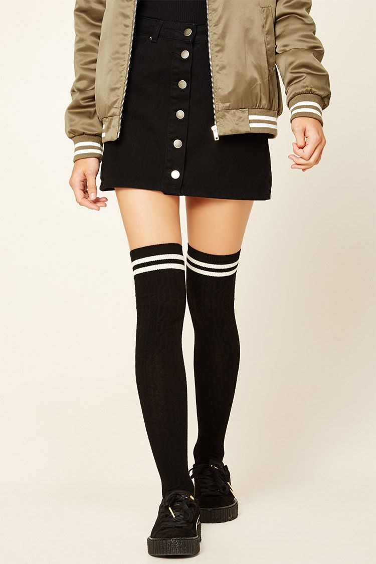 add5fbe4b A pair of cable knit over-the-knee socks featuring varsity stripes ...