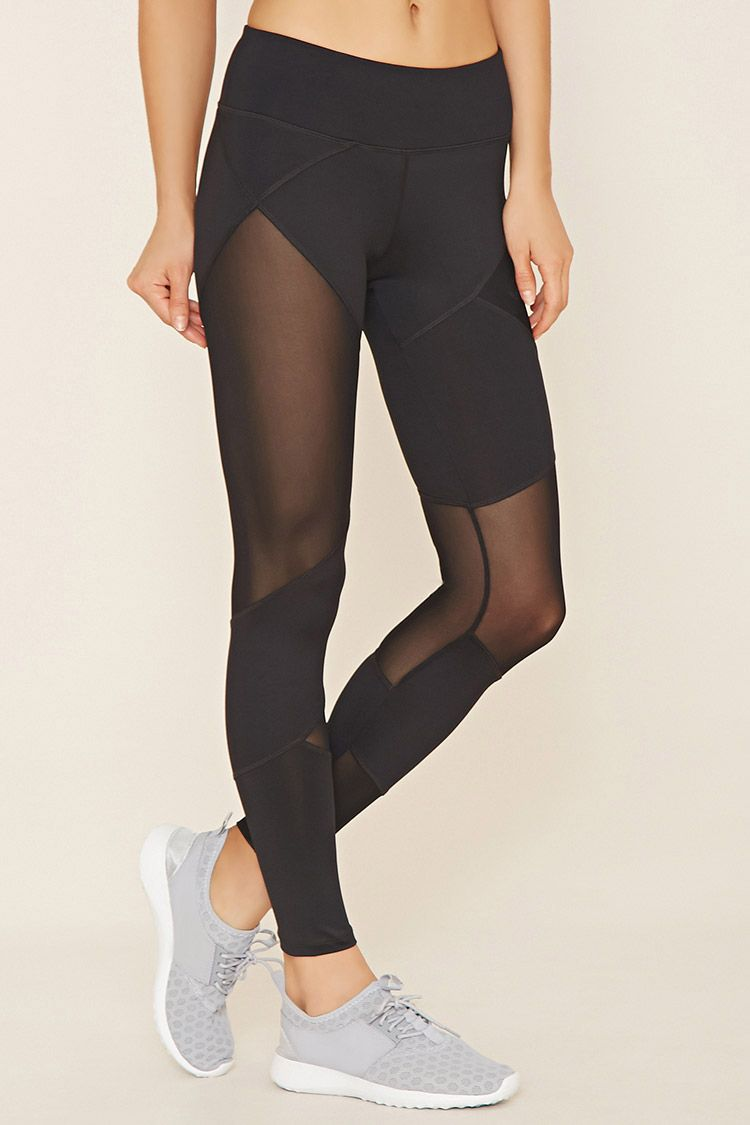 A pair of stretch knit athletic leggings with a sheer mesh insert on each leg, a zipped mesh pocket in front, and moisture management.