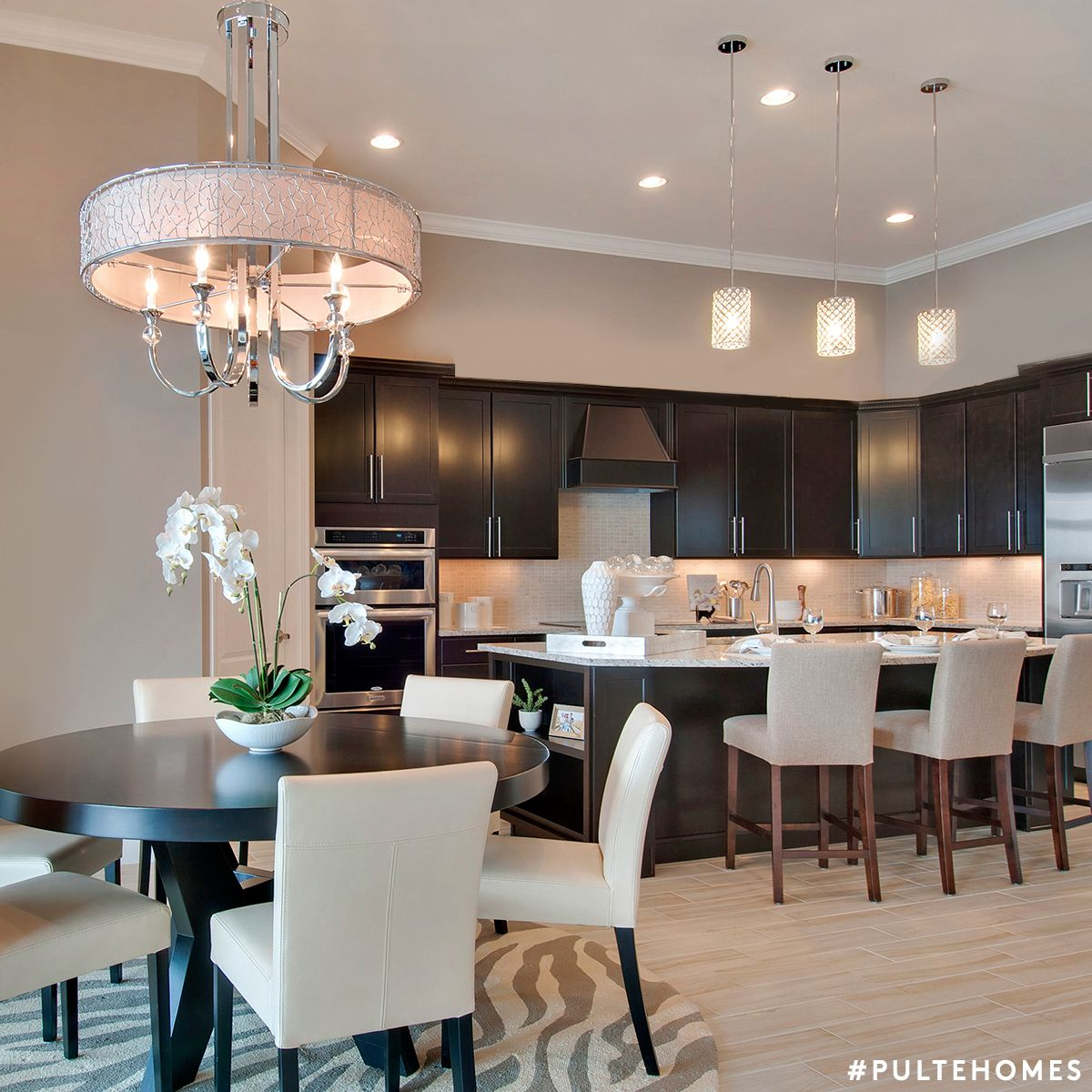 An open floor plan with shades of brown and creamy whites is both warm and inviting