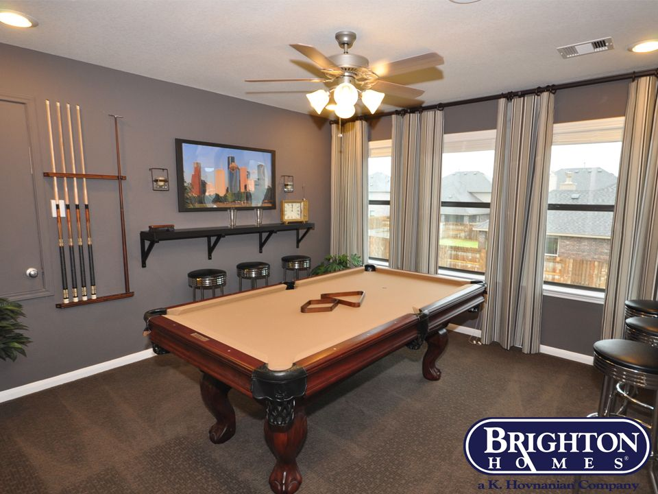 Gameroom With Wall Mount Bar Shelves And Pool Table