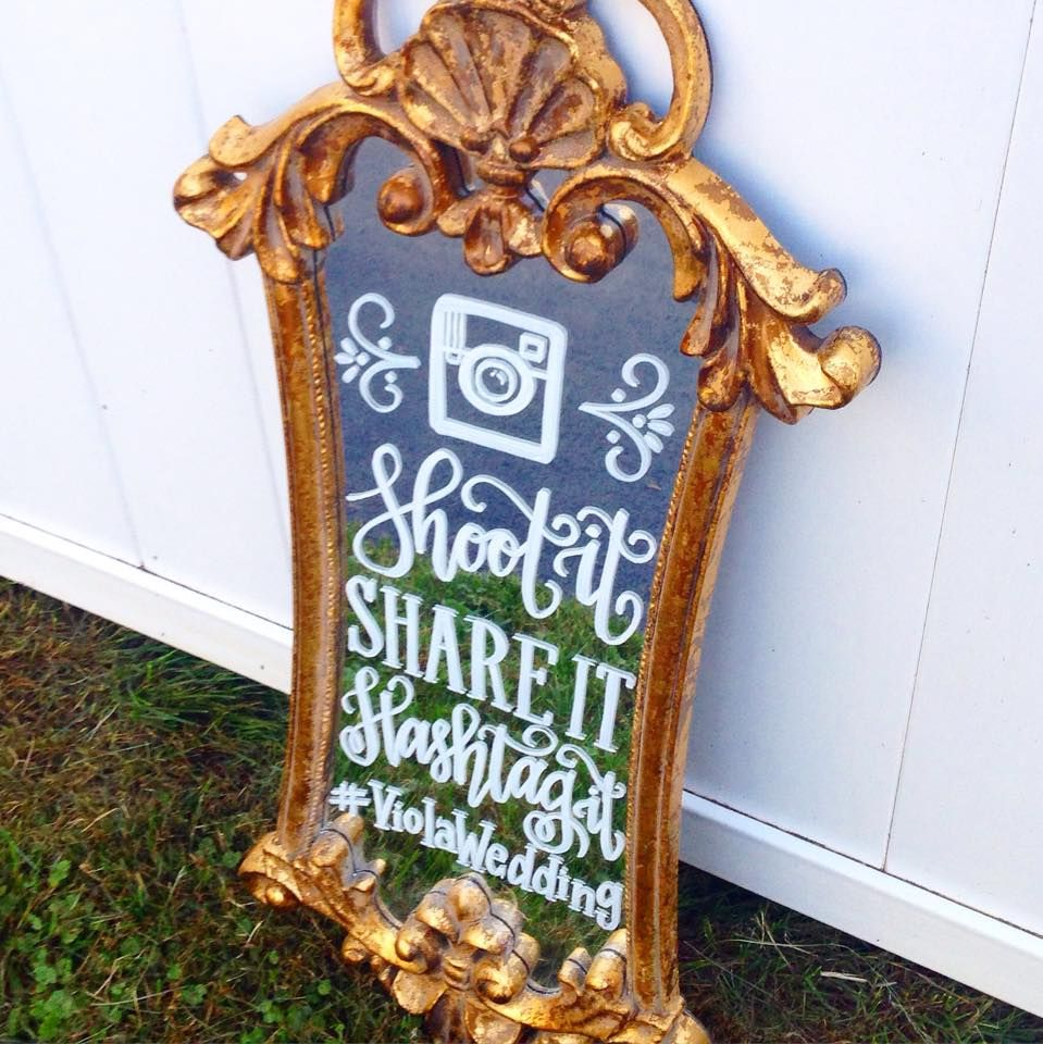 """""""Shoot it, Share it, Hashtag it"""" Sign lettered on a Mirror"""