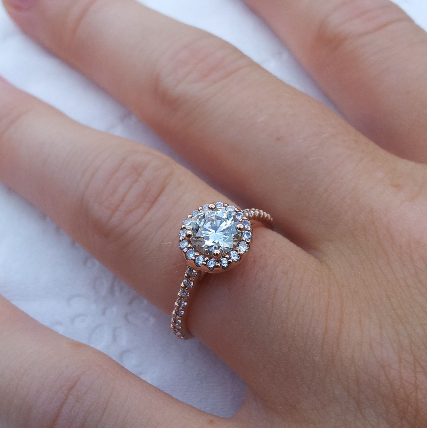 18k rose gold with a 34k center stone engagement ring