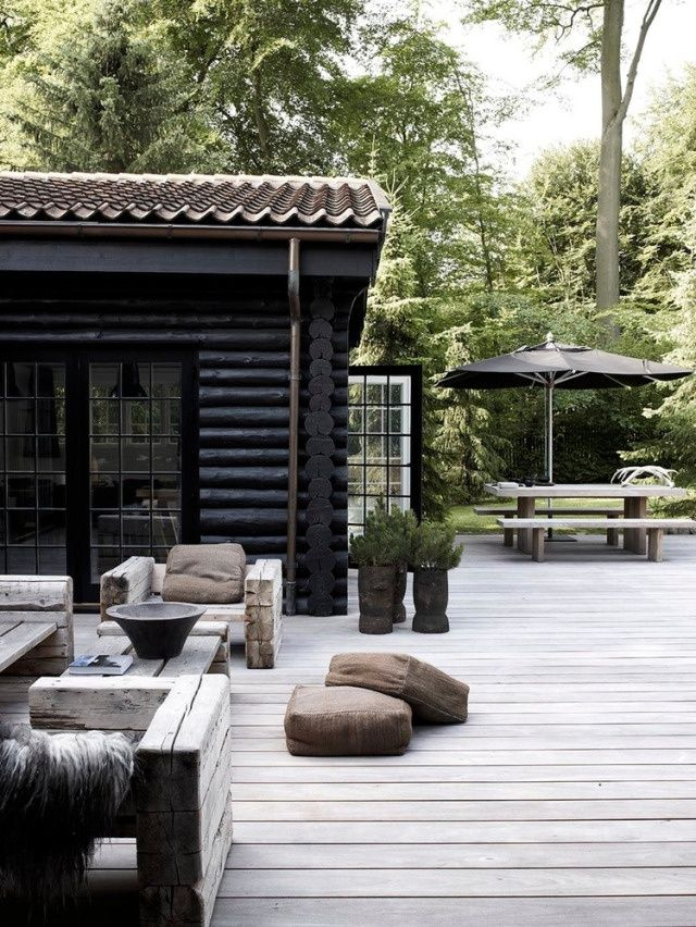 This Log Cabin With A Beautiful Black Exterior This Looks Like An