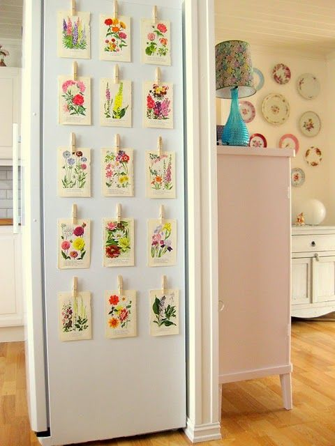 florals for the home  Love the side fridge decor and the wall of plates...the lamp and the super cute pink dresser. :)