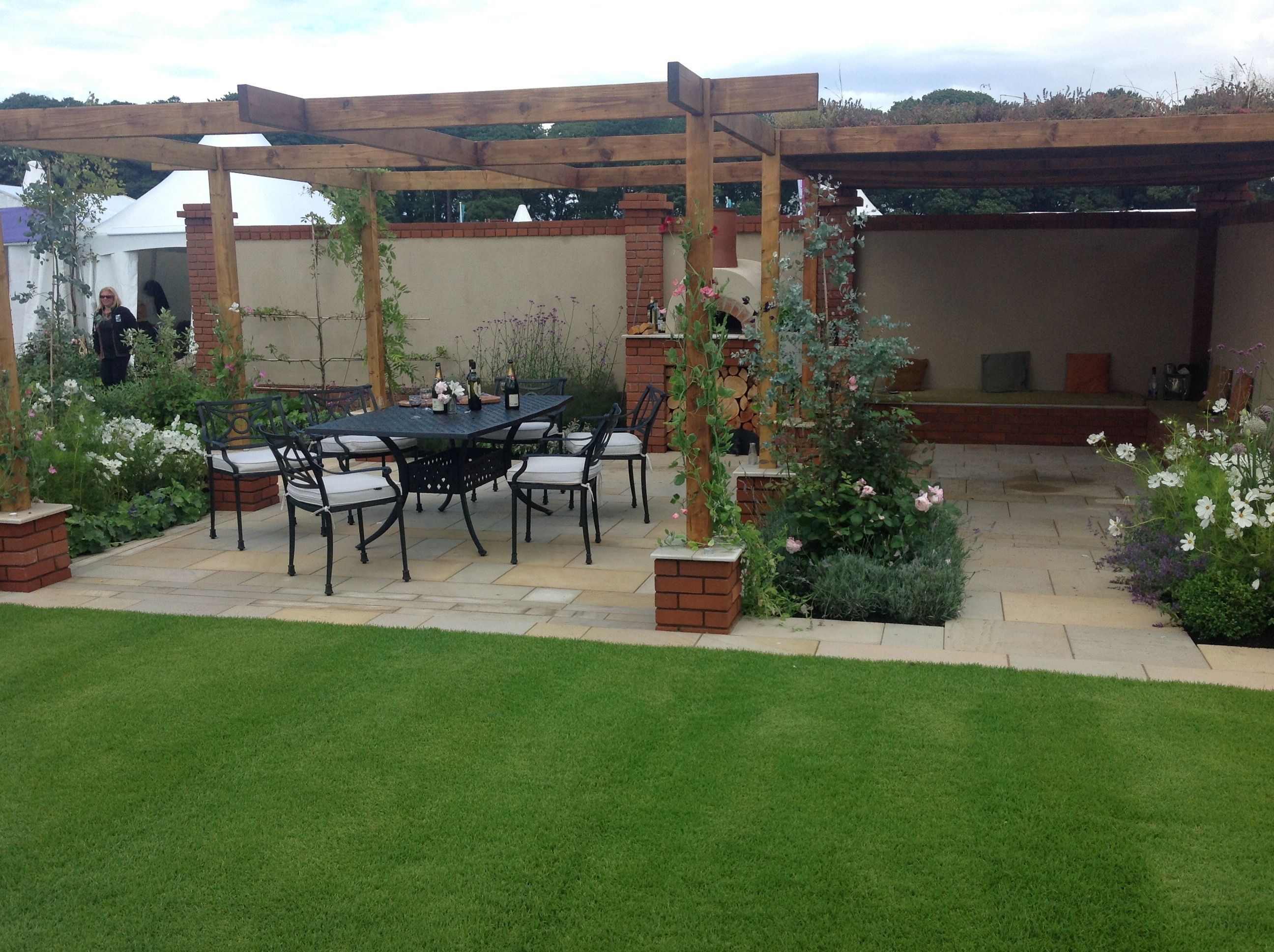 Cooking, dining patio with lawn and flower beds