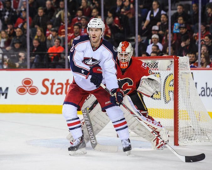 Boone Jenner #38 Columbus Blue Jackets and Reto Berra #29 Columbus Blue Jackets