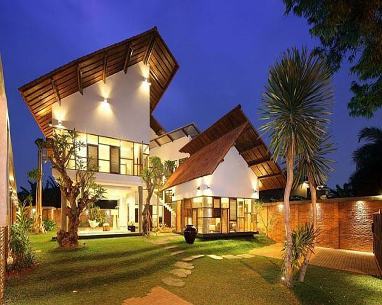 Fascinating tropical roof design representing elegant lighting system and brown wooden gable end roof rongent