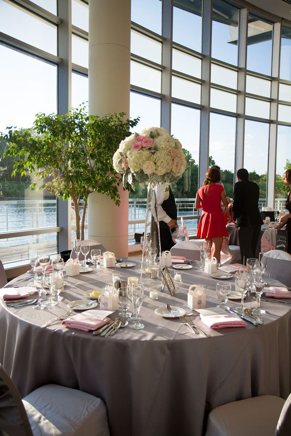 Wedding Reception Centerpieces at Esplanade Lakes.  Tall with hydrangea, roses, and dusty miller.  Classically beautiful in blush pink and silver grey tones.