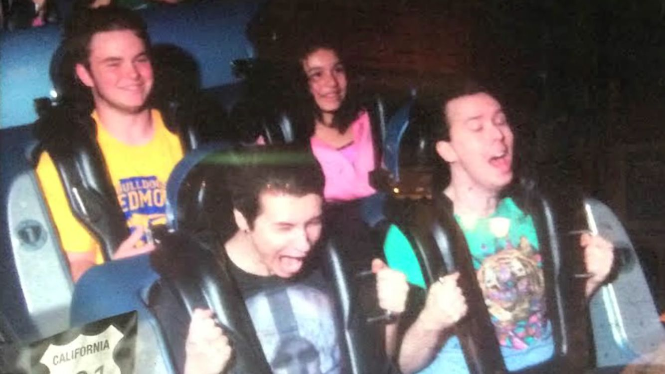 Dan and Phil on Rockin' Rollercoaster (when I went on that roller coaster, my face looked exactly like Dans.)