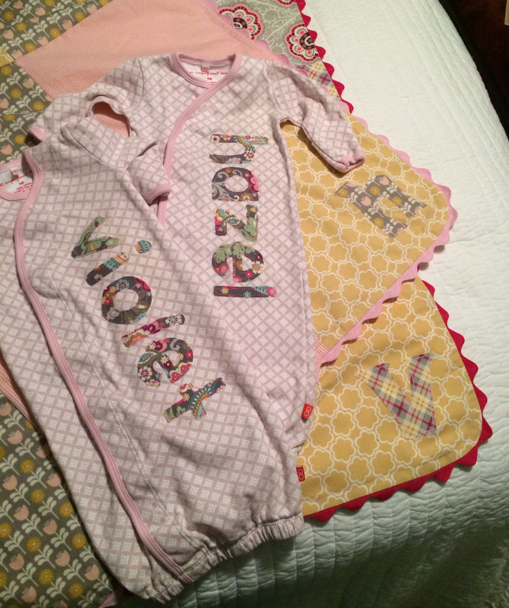 Twinsies. Matching baby blankets and gowns with names.