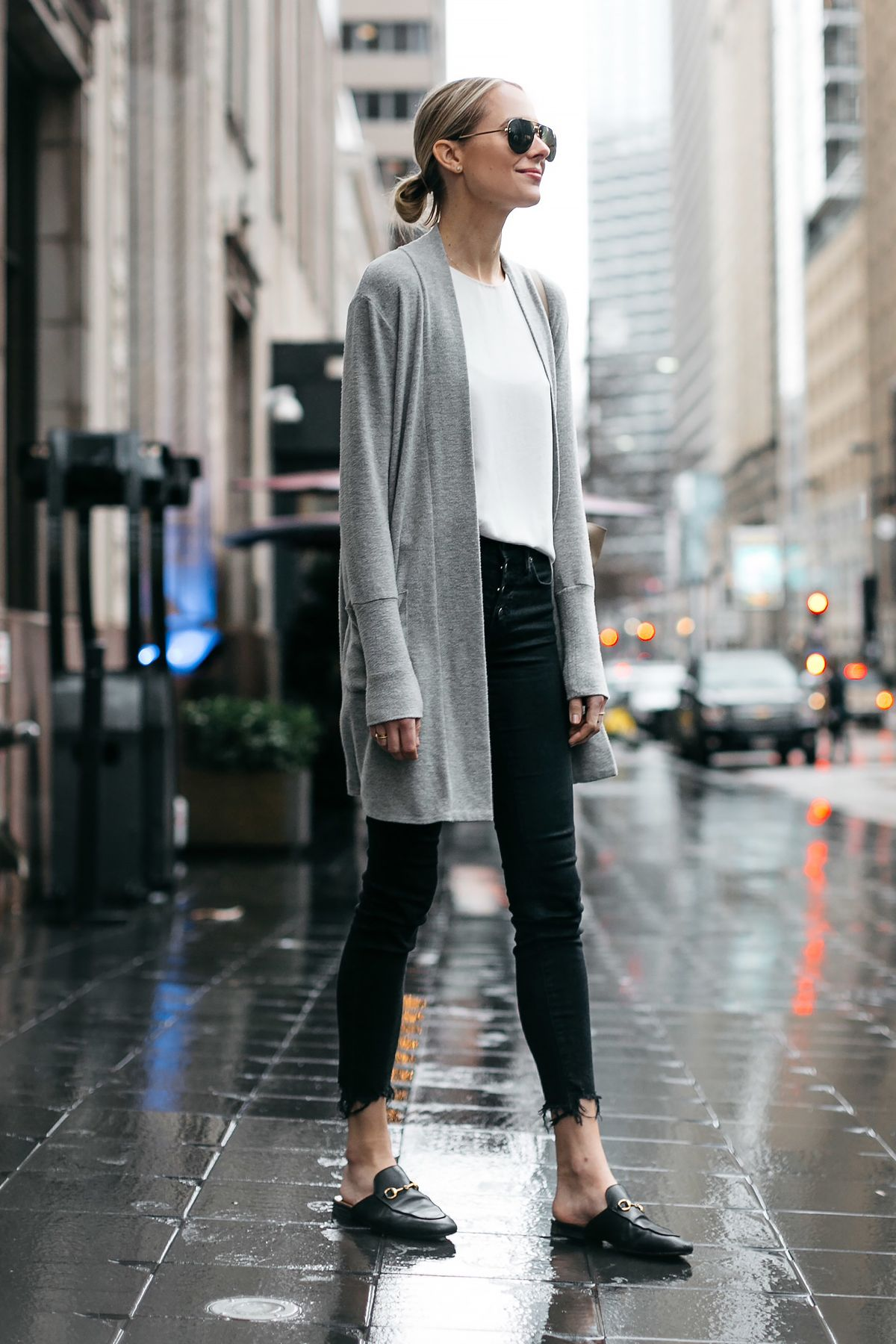5771a7e8bf26 Blonde Woman Wearing Grey Long Cardigan Madewell Black Ripped Skinny Jeans  Gucci Princetown Black Mules Fashion Jackson Dallas Blogger Fashion Blogger  ...