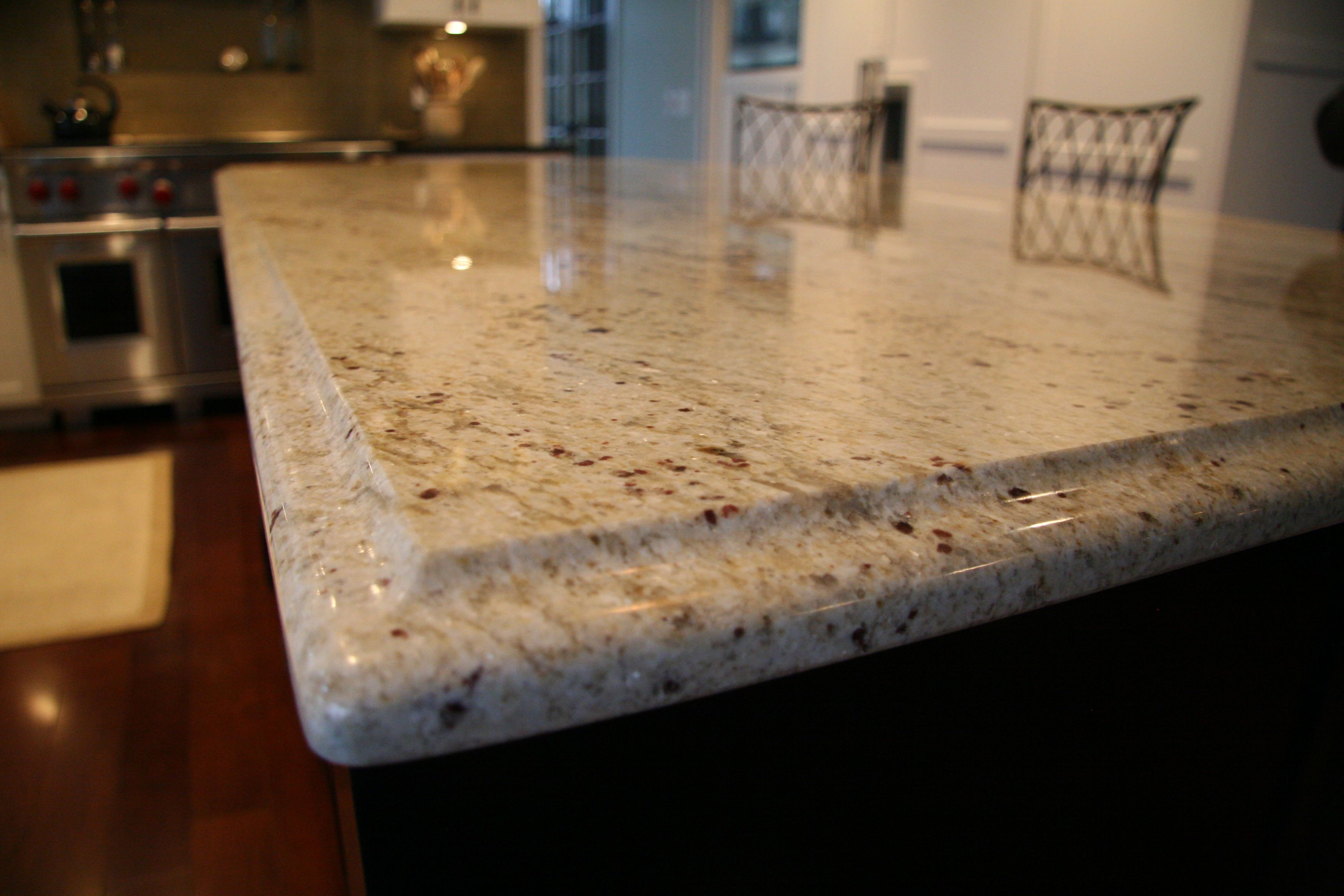 Colonial Cream Granite Island Counter With Ogee Edge Profile
