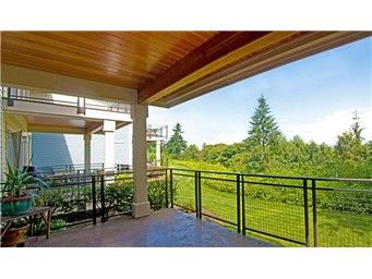Enjoy easterly sunrises & Mount Baker views from this contemporary open-concept home. Located in a gated community, this end unit is quiet and private. Many amenities in this home that include hand-scraped hard wood floors, granite, under-counter lighting, stainless Bosch appliances, maple cabinetry and custom plantation shutters in both bedrooms. Large Master with ample closet space and spa-like MB with over-sized tiled shower, travertine and granite counter tops. High efficiency heat pump.