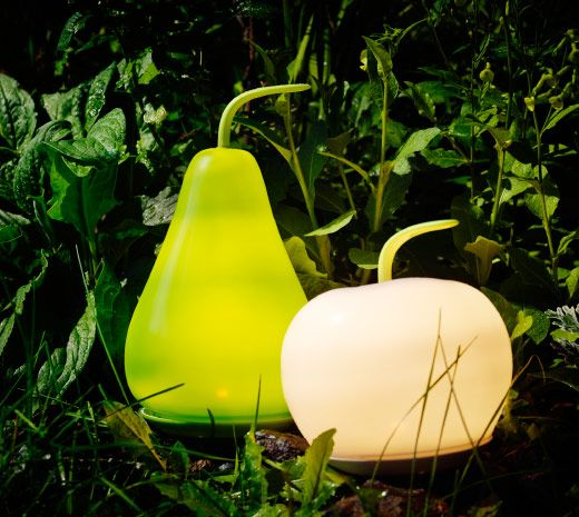 Outdoor Party Lights Ikea: A Dark Garden With Lit LED Solar-powered Floor Lamps That
