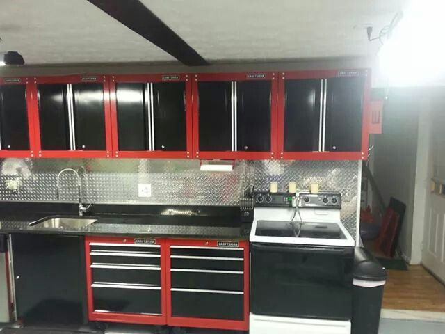 Tool box kitchen... This would be awesome in Rob's garage.. Minus the range and add the beer fridge!