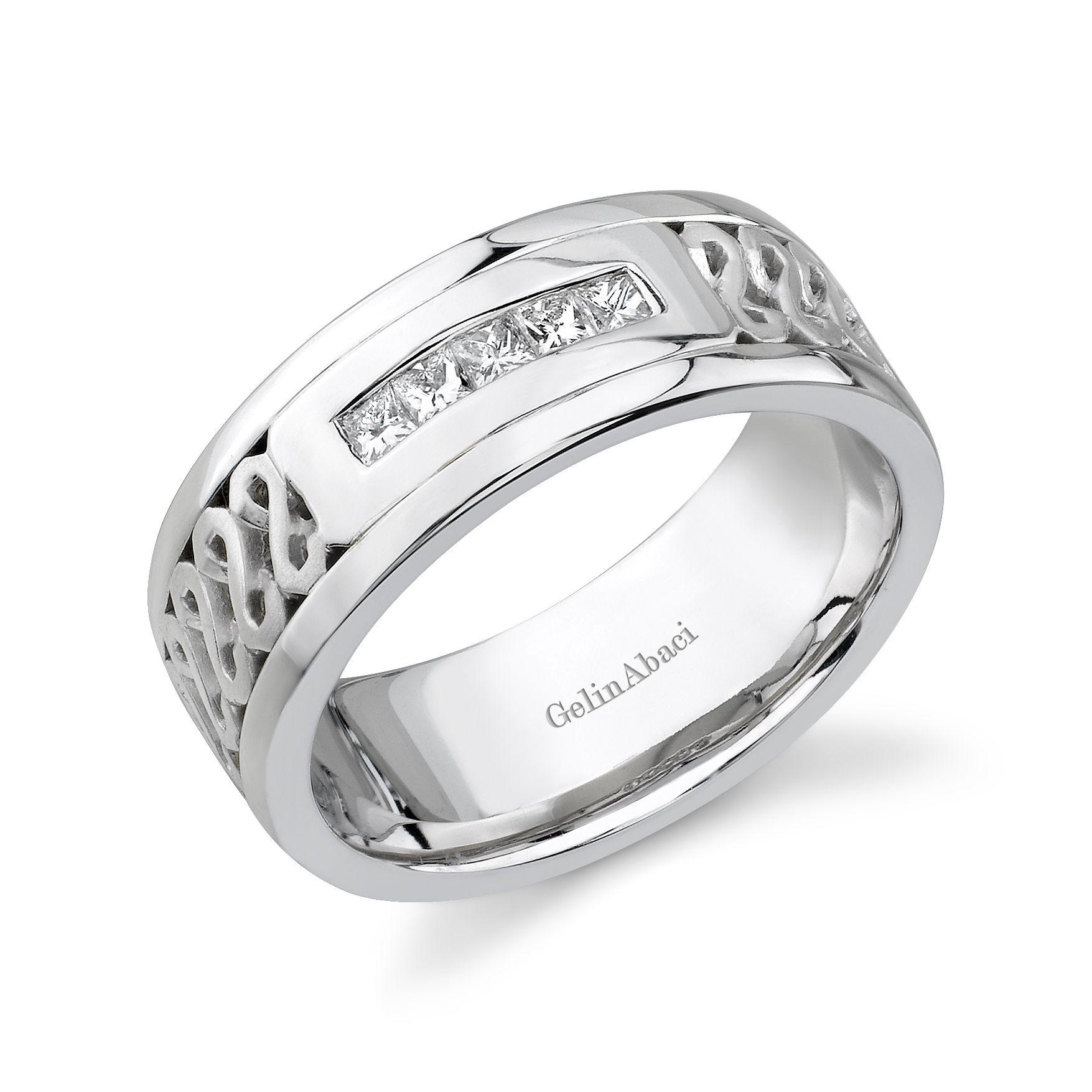 Beautiful diamond and platinum wedding band for him.